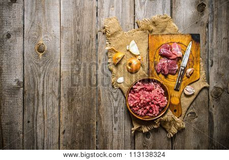 Prepatared Of Meat. The Preparation Of Minced Meat And Onions On The Old Fabric.