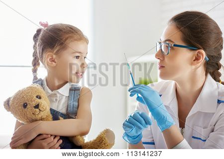 A doctor makes a vaccination to a child