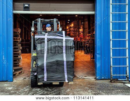 Forklift At Large Warehouse