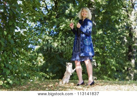 Lady gives commands to her little friend