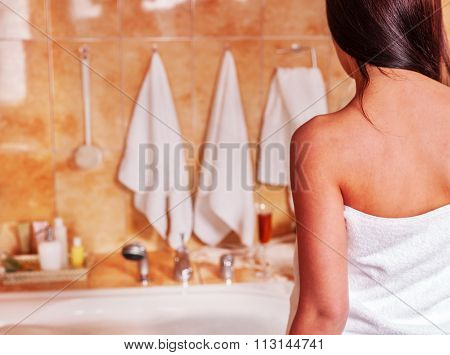 Interior of bathroom with young woman take bubble  bath.