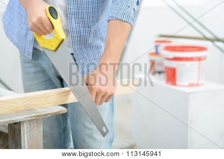 Pleasant man doing renovation