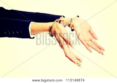 Arrested businesswoman hands with handcuffs.