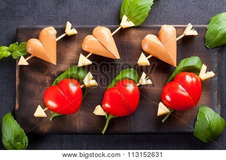 Marinated fillet with tomato and sausage heart shaped.