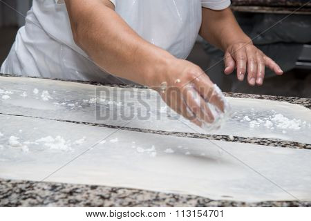 Close Up Of Female Hands Kneading Dough And Making Banitsa