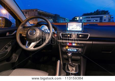 PRUSZCZ GDANSKI, POLAND - SEPTEMBER 24, 2014: Interior of new Mazda 3 captured at dusk with long exposure technique. Mazda 3 is a popular compact car manufactured in Japan.