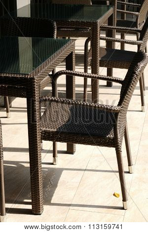 Black Wicker Chair And Table On The Terrace