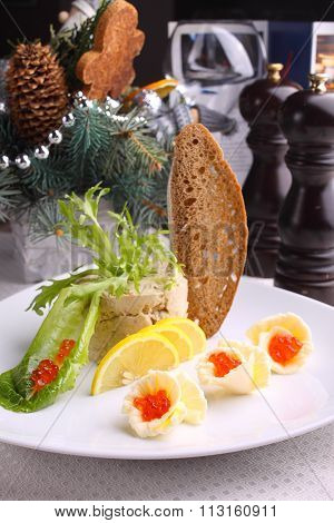 Forshmak Decorated With Salad , Lemon And Red Caviar Bread