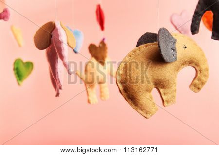 Fleece elephants on pink background