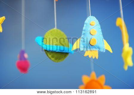Fleeced space decor on blue background