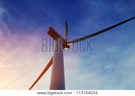 Windmill outside the city, renewable energy sources