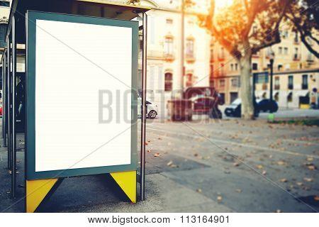 Public information board on the street, advertising mock up empty banner in metropolitan city