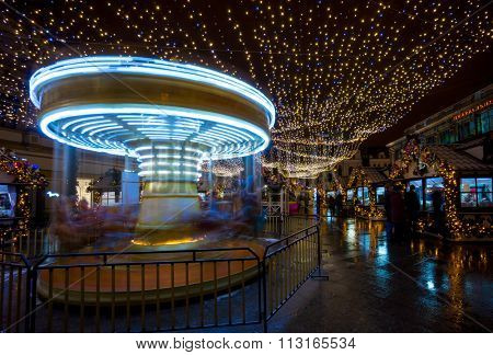 Merry-go-round carousel at evening at Christmas Fair