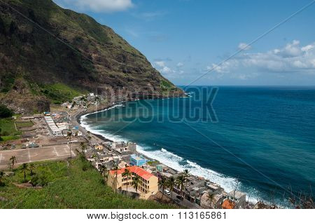 Small town with soccer football pitch at black rock stone beach coast on cape verde island