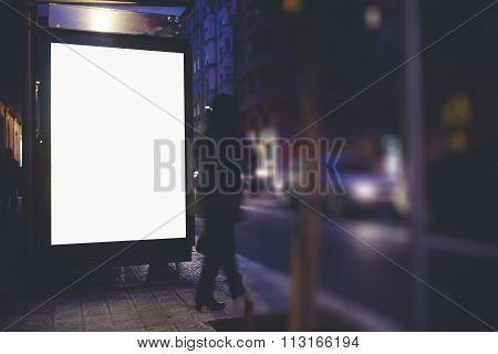 Public information board on the bus stop, empty advertising mock up banner in metropolitan city