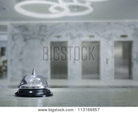 Hotel lobby with service bell and elevators