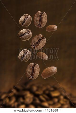 Closeup of coffee beans falling