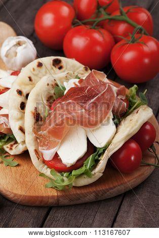 Piadina romagnola, italian flatbread sandwich with prosciutto and mozzarella cheese