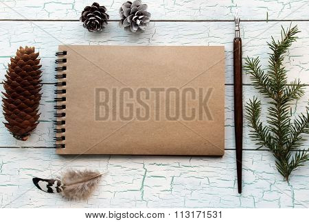 Mockup Concept With Feather And Pine Cones