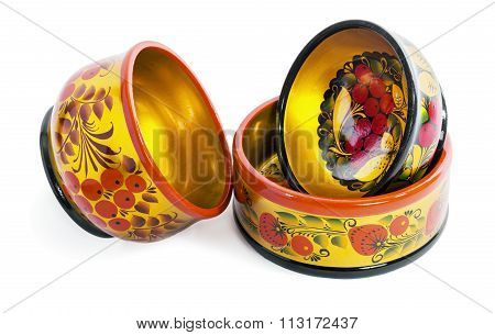 Three wooden  bowls, painted in the style of Khokhloma
