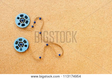 Two Little Movie Reel Connected With Filmstrip Path