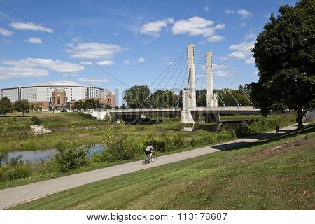 The Lane Avenue bridge in Columbus, Ohio is enjoyed by bikers and runners along the Olentangy River.