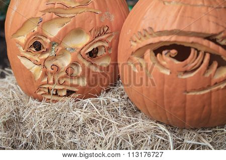 Two dramatic Halloween pumpkins on straw bale e Designs