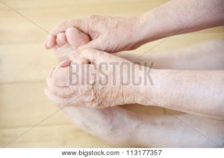 Senior man stretching to hold toes