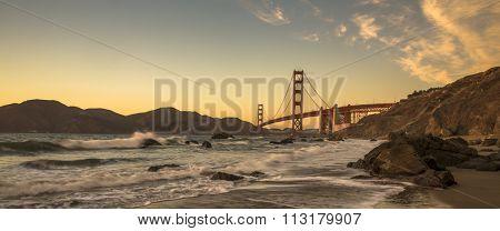 Golden Gate Bridge, San Fransisco, California, USA during sunset shot from the beach