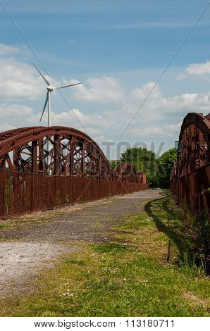 New wind turbine and old bridge