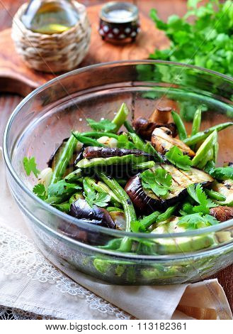 Grilled vegetables - zucchini, eggplant, green beans, onion, mushrooms, garlic and coriander, olive