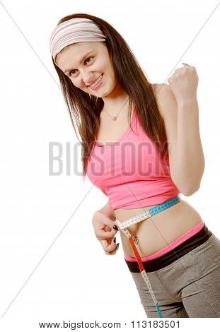 Young Girl Making Measure Around Her Waist With Measuring Tape