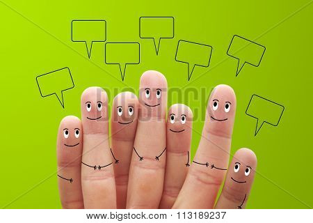 Happy Finger Smileys With Speech Bubbles On Green Background