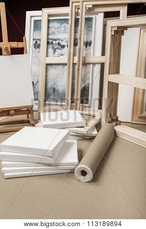Empty White Painter Canvases And Canvas Roll And Easel - Painters Program