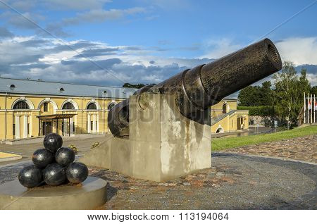 Vintage cannon and cannonballs in Daugavpils fortress near Mark Rothko Art Centre