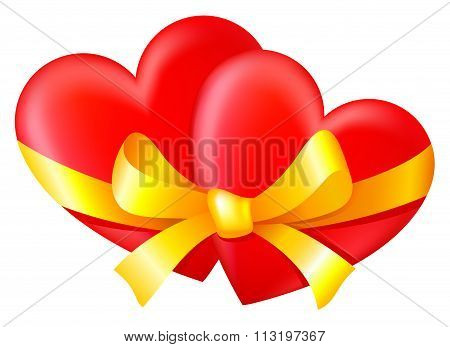 Two hearts tied with a gold ribbon with a bow