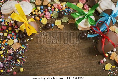 Chocolate Candy Eggs Biscuits Candies On A Wooden Table