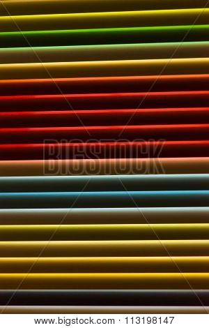 Colorfull metal window blinds. Roller shutter background. Part of a metal blind with multiple colour
