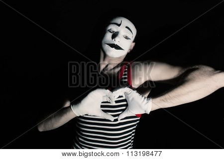 Sad mime with heart