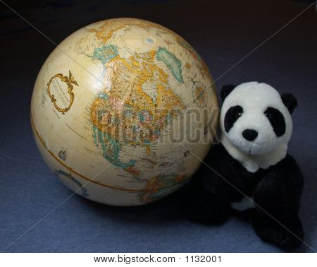 The World Globe And A Giant Panda
