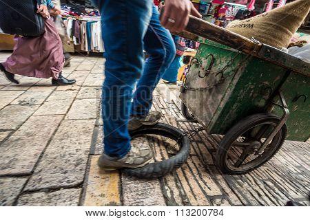 Street Seller Distributing Goods On Narrow Streets Of Jerusalem.