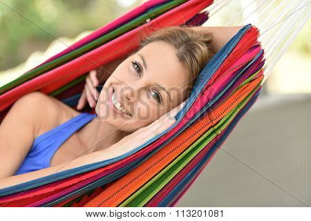 Portrait of smiling girl relaxing in hammock