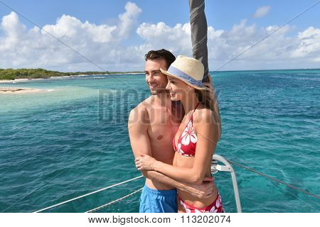 Cheerful couple having fun on a catamaran