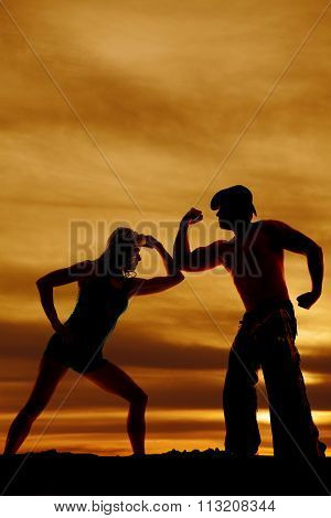 Silhouette Of Cowboy And Woman With Muscles