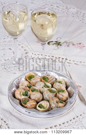 White Wine In Wine Glasses And Snails