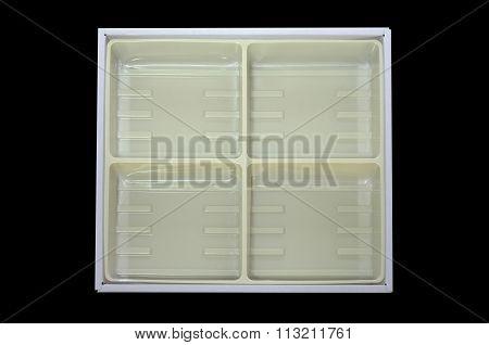 Empty plastic tray inside paper box