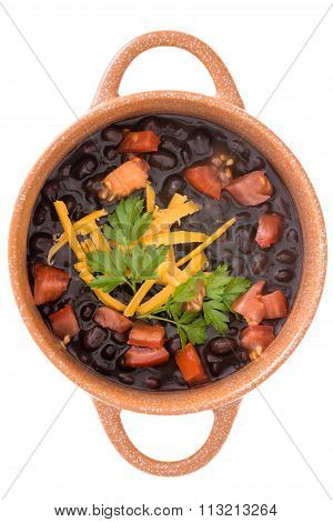Bowl Of Black Bean Soup Garnished With Cheese