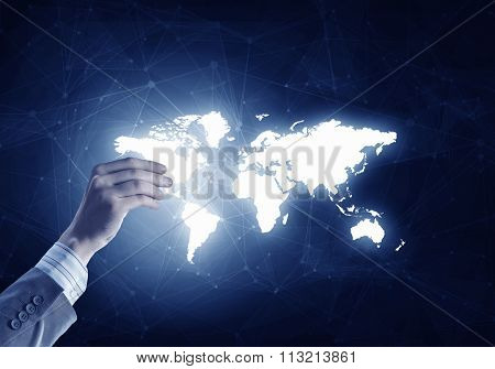 Man hand holding digital world map representing global technologies concept