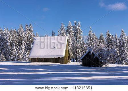 Snow Layered On Barns Roof.