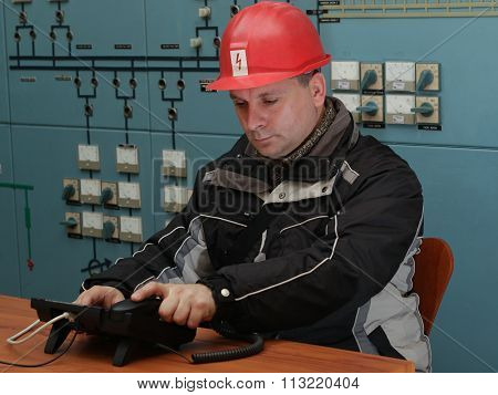 Technician Prepare To  Make  Phone Call In The Power Plant Control Center